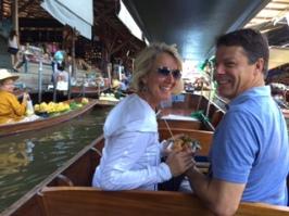 Enjoying authentic Thai Egg Rolls while touring the floating market