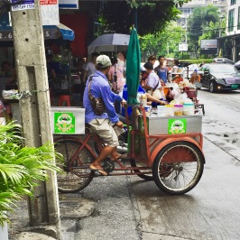 Bike Vendor making his way up the street in Bangkok