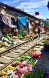 Vendor stalls at the Maeklong Railway Market